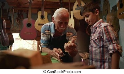 7-Old Lute Maker Teaching Grandson Boy Chiseling Wood