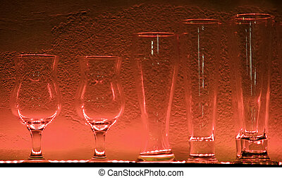 7 Wine glasses and glasses on a shelf in a bar