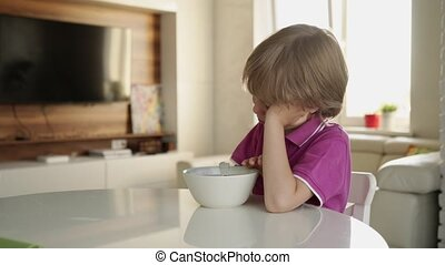 7 year old caucasian boy refuses to eat soup. Child hate ...