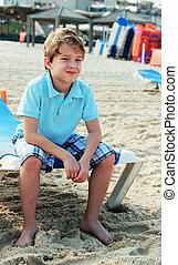 7 years old boy on the beach