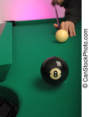8 Ball in the side pocket on a pool (billard) table during play