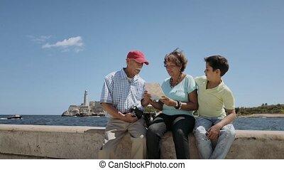 8-Family Grandparents Reading Tourist Map In Habana Cuba