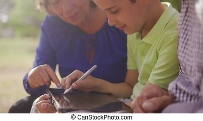 8-Grandparents And Grandson Drawing School Notes On Tablet PC