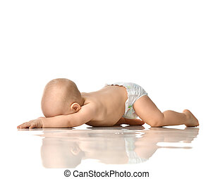 8 month infant child baby girl toddler lying on floor in diaper isolated on a white