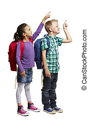 8 year old school boy and girl with backpacks pointing and smiling on white background