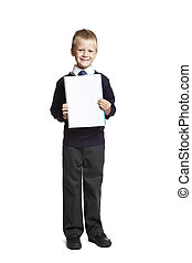 8 year old school boy with blank notepad on white background