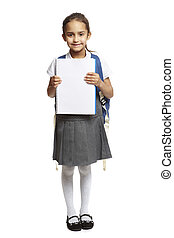 8 year old school girl with backpack holding blank notepad smiling on white background