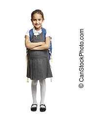 8 year old school girl with backpack smiling on white background
