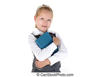 8 year old school girl with book smiling on white background