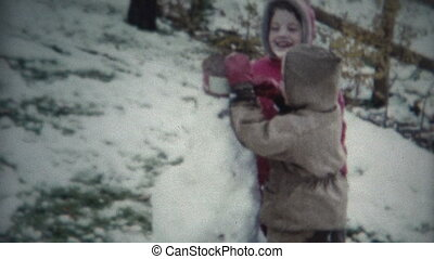 (8mm Film) Kids Building Snowman
