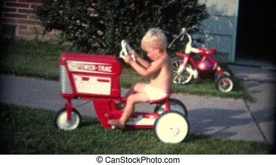 (8mm Vintage) Boy Riding Toy