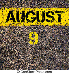 9 August calendar day over road marking yellow paint line