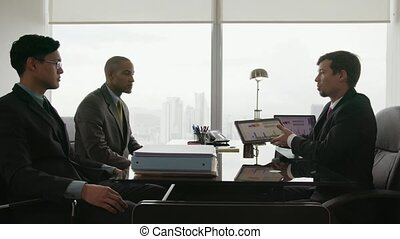 9 Business People Team Meeting With Advisor Examining Charts