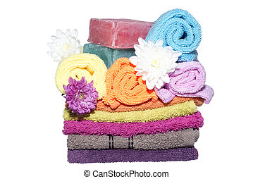 9 facecloths off various shades flowers and soaps