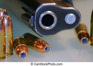 Business end of a 9mm semi auto handgun with hollowpoint ammunition