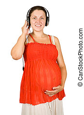 pregnant woman listening to music