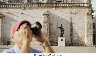 9-Old Man Tourist Taking Souvenir Picture With Photo Camera...