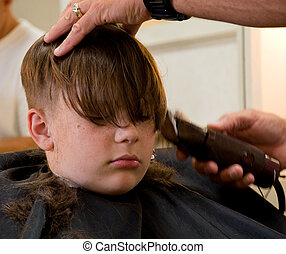 9 Year Old Boy Getting Haircut - This 9 year old Caucasian...