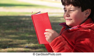 9 year old boy reading a kids book