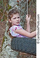 9 Year Old Caucasian Girl in Tire Swing