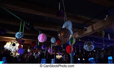 Ceiling decorations for a 90s party in a restaurant