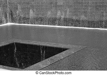 9/11 memorial fountain in black and white