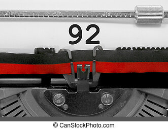 92 Number by the old typewriter on white paper - 92 Number...