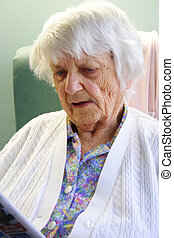 94 year old Senior citizen reading newspaper
