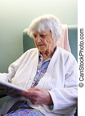 Senior citizen - 94 year old Senior citizen reading ...