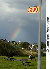 999 sign. - An emergency number sign '999' in red on yellow...