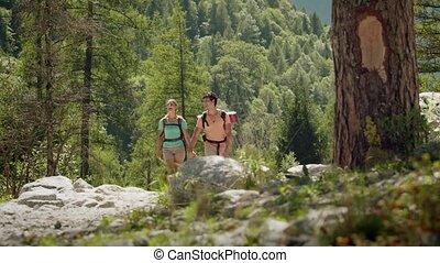 9of12 Two people hiking, trekking