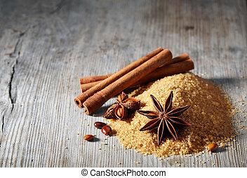 açúcar marrom, varas canela, e, anis estrela