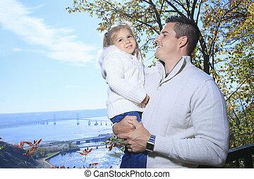 a, 幸せな家族, 楽しい時を 過すこと, 屋外で, 中に, 秋