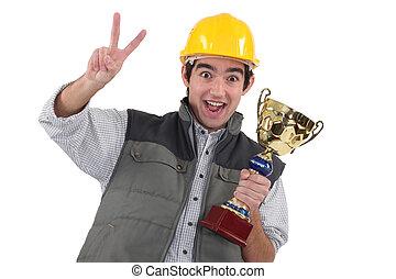 a, 建築作業員, 保有物, a, trophy.