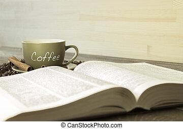 a, 杯咖啡用豆, 上, the, 背景, ......的, a, book., 集中, 上, the, 杯子