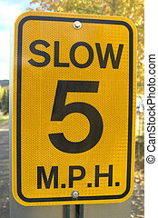 slow sign - a 5 miles per hour slow sign