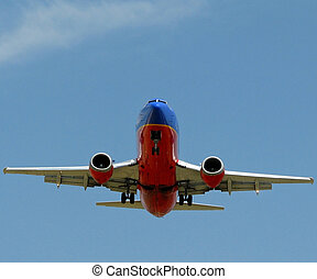 A 737 plane with the landing gears down.