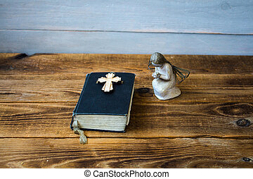 a angel old bible and cross