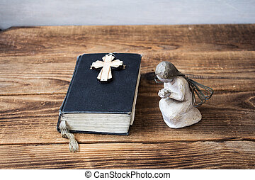 angel old bible and cross