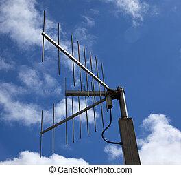 a antenna with blue sky