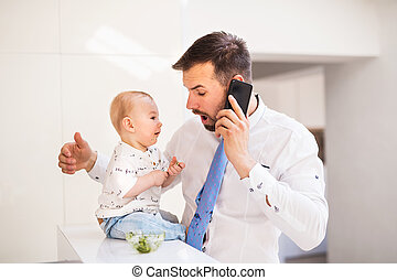 A baby boy making his fathers tie dirty when eating.