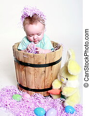 easter celebration - a baby playing in easter celebration...