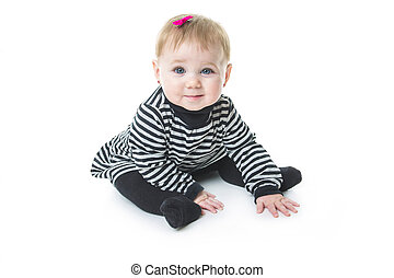 baby sitting on the floor, isolated over white