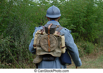 back view of a 1918 French soldier in the countryside