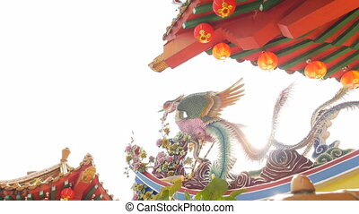 A backlit shot of a phoenix detail at a buddhist temple -...