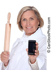 A baker holding a mobile phone