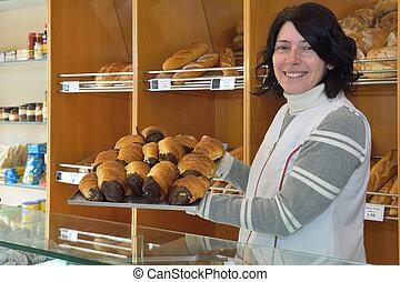 a baker in her bakery
