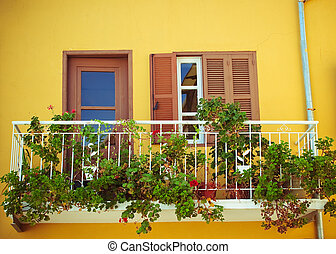 a balcony with flowers