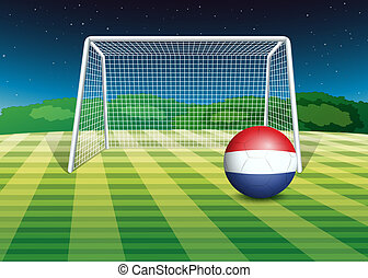 A ball at the field with the flag of Netherlands