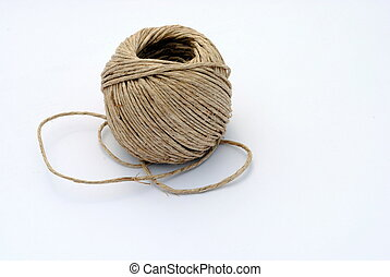 a ball of twine on white background, soft shadows